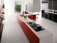 Red-kitchen-units-white-corian-worktop