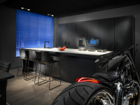 bachelor-kitchen-roaring-motorbike-blue-screen-wndow-black-cabinetry