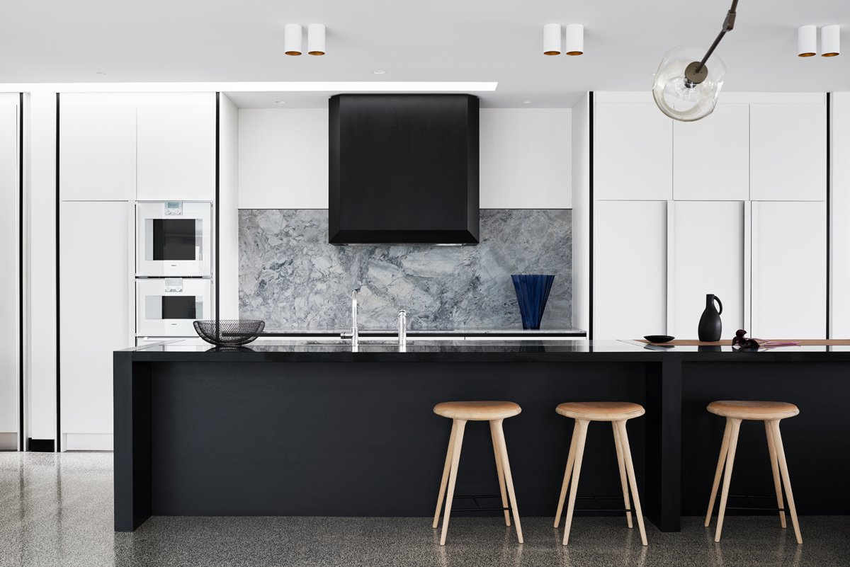 black-cabinetry-grey-marble-kitchen