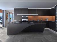 black-curved-bench-kitchen-amber-inlet-chrome-lighting