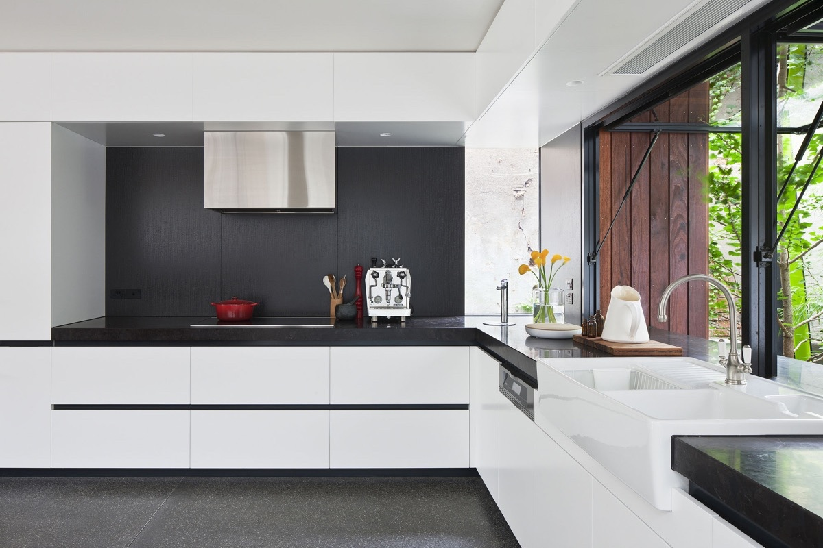 black-kitchen-countertops-with-white-cabinets