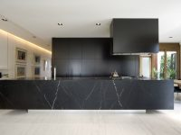 block-black-kitchen-large-marble-benchtop-wooden-flooring
