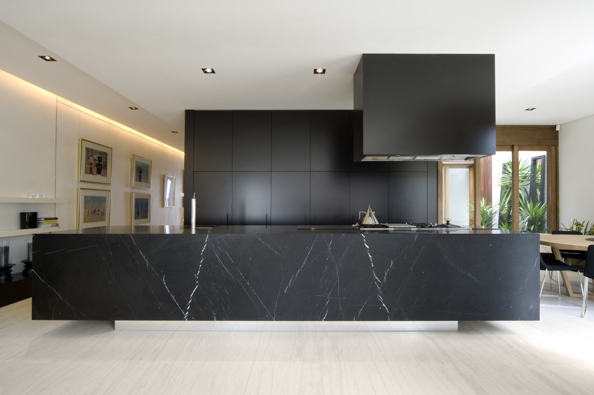 block-black-kitchen-large-marble-block-benchtop-wooden-flooring