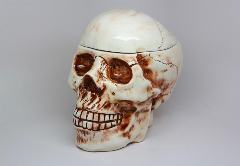 brown-and-white-ceramic-skull-cookie-jar