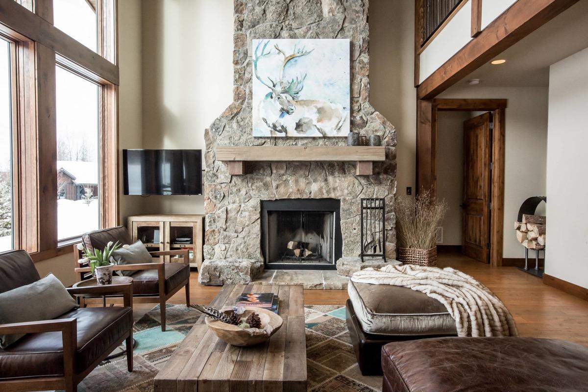 stone-fireplace-woollen-throw-rustic-living-room-design