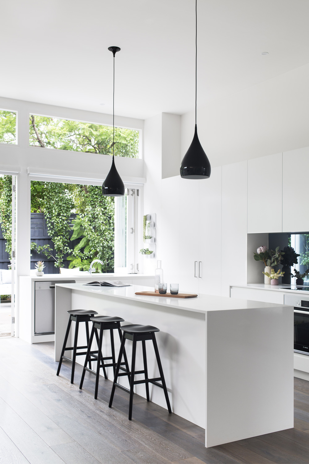 white-kitchen-with-black-stools