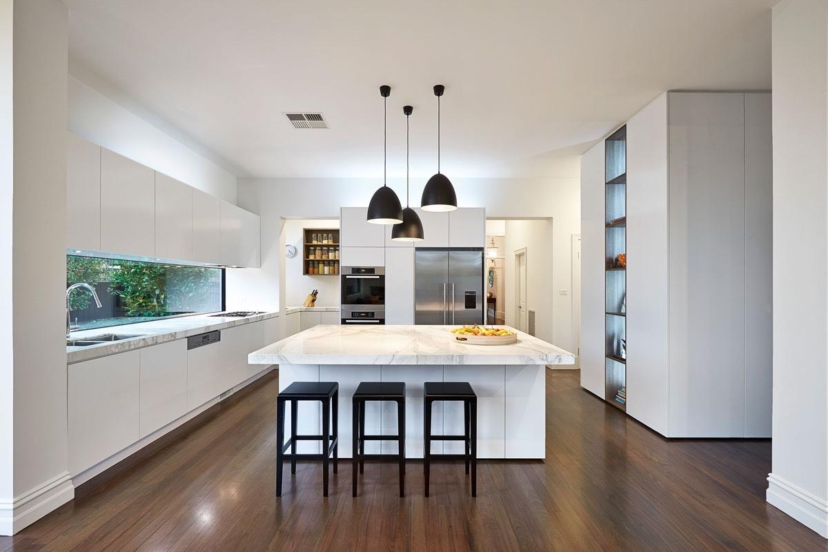 wooden-floor-black-fixtures-marble-kitchen