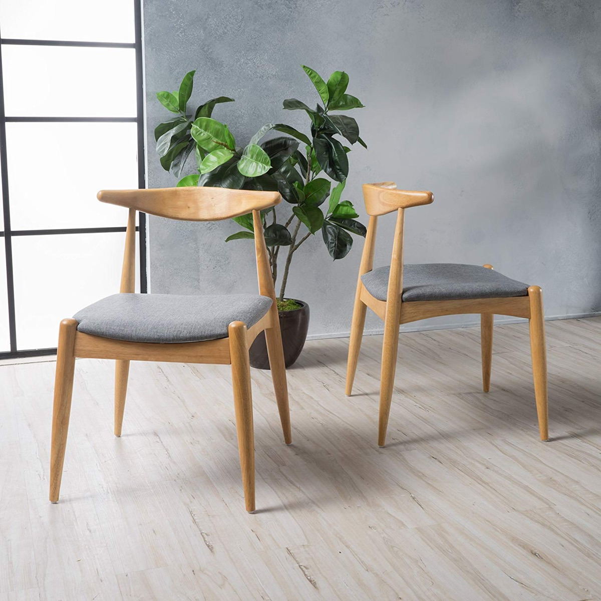 Wegner-Elbow-Style-Kitchen-Chairs-With-Grey-Cushions-And-Wood-Base