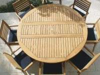 Avant 9 Piece Teak Patio Dining Set W/ 72 Inch Round Drop Leaf Table And Sunbrella Canvas Navy Cushionsroyal Teak Collection for Beautiful Teak Outdoor Furniture Set