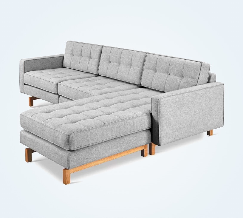 bi-directional-tufted-sectional-sofa-with-chaise-in-grey-upholstery-with-wood-legs