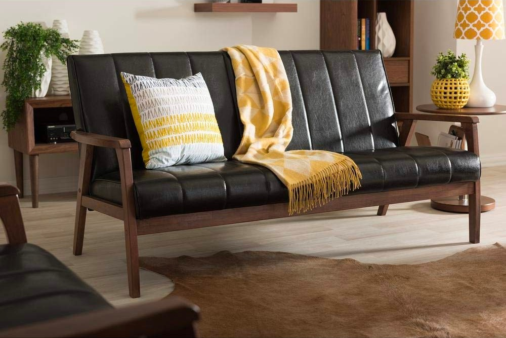 black-leather-tufted-sofa-with-channel-tufting-and-solid-walnut-frame