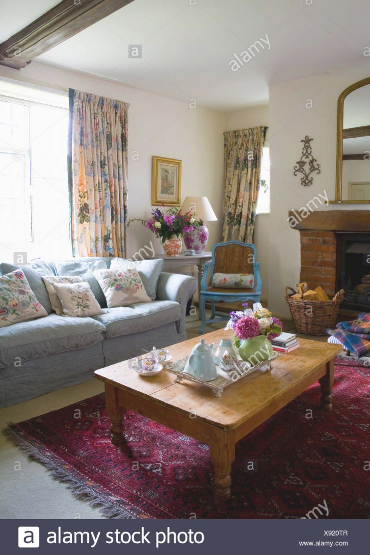 Blue Sofa In Front Of Window With Floral Curtains In Country within New Floral Living Room Furniture