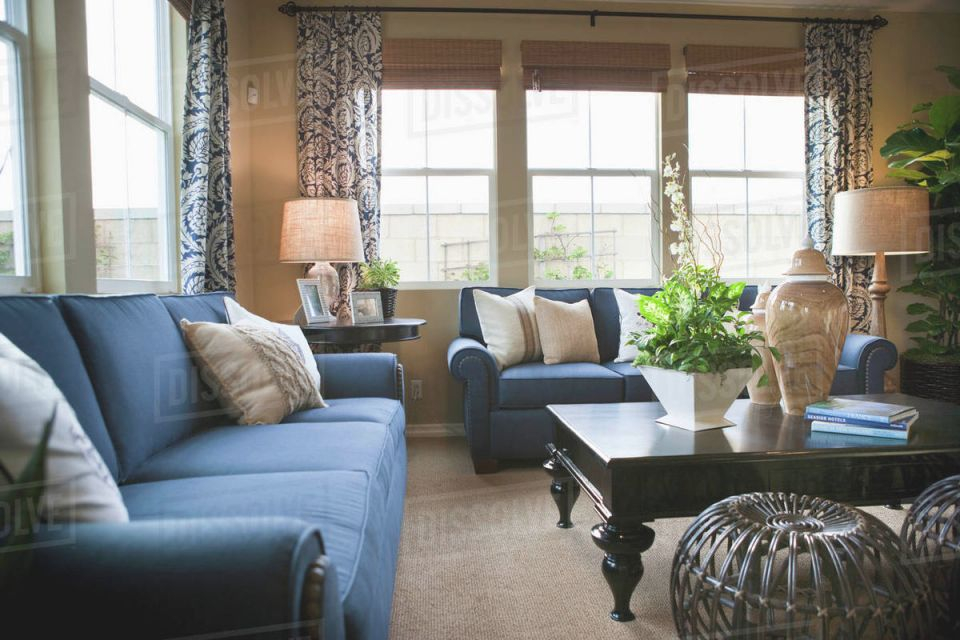 Blue Sofas In Traditional Living Room Stock Photo intended for New Traditional Living Room Furniture