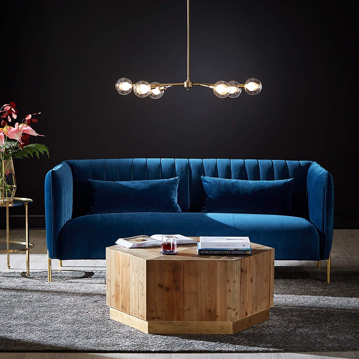 blue-velvet-tufted-sofa-with-brass-legs-for-hollywood-regency-interior-decor-style