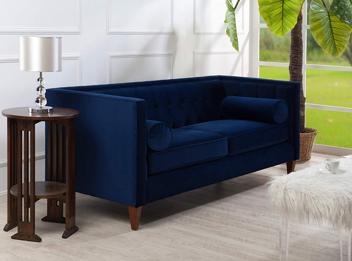 dark-navy-blue-tufted-sofa-with-velvet-upholstery