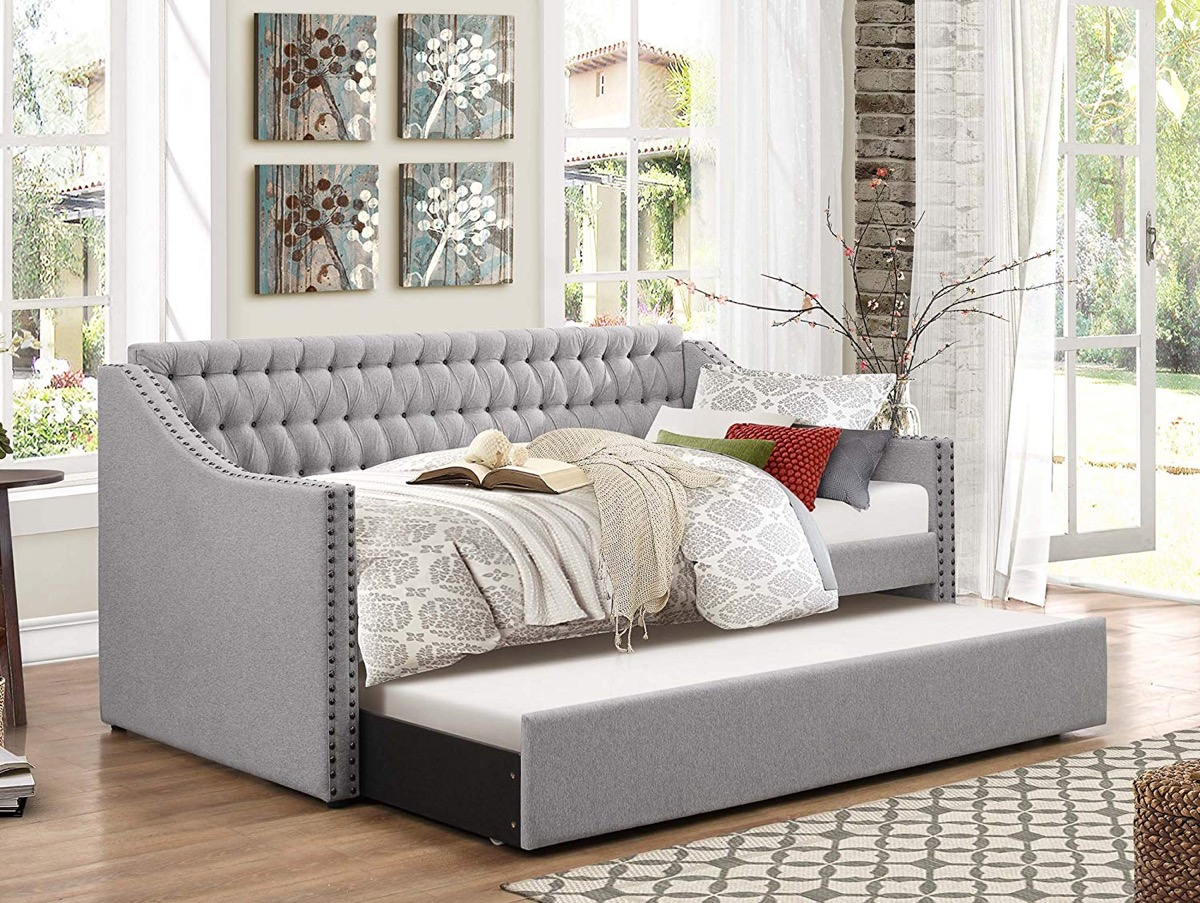 elegant-track-arm-tufted-gray-sofa-with-twin-sized-trundle-bed