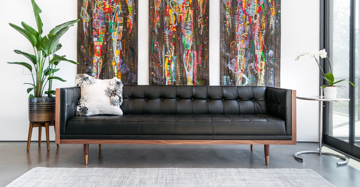 mid-century-modern-black-leather-tufted-sofa-enclosed-with-ash-wood