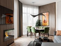 modern-chandelier-in-open-concept-dining-room-decorated-in-green-and-orange-accents