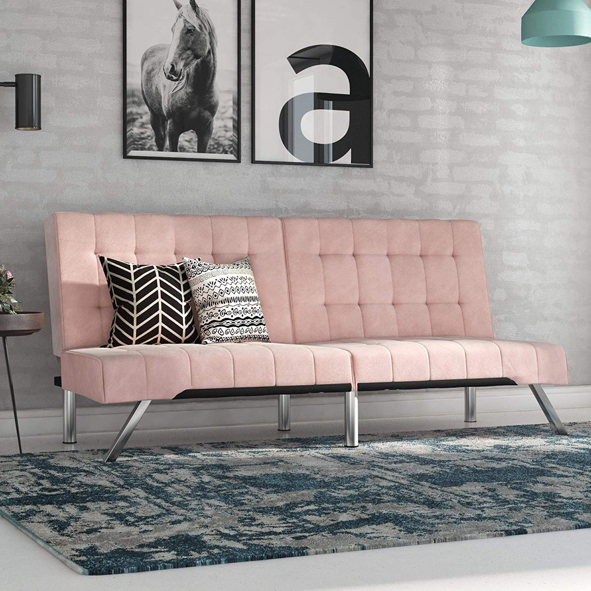 pastel-pink-tufted-sofa-bed-with-chrome-metal-legs
