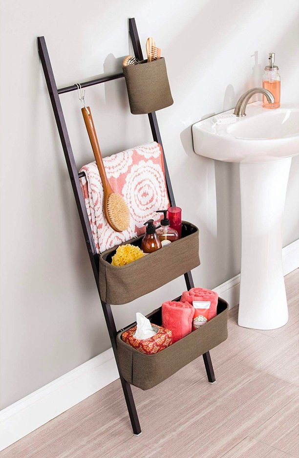 small-ladder-shelf-with-baskets-and-hooks-for-the-bathroom