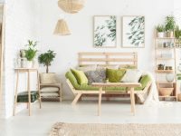 Table And Plants On Wooden Shelf In Floral Living Room Interior.. pertaining to Floral Living Room Furniture