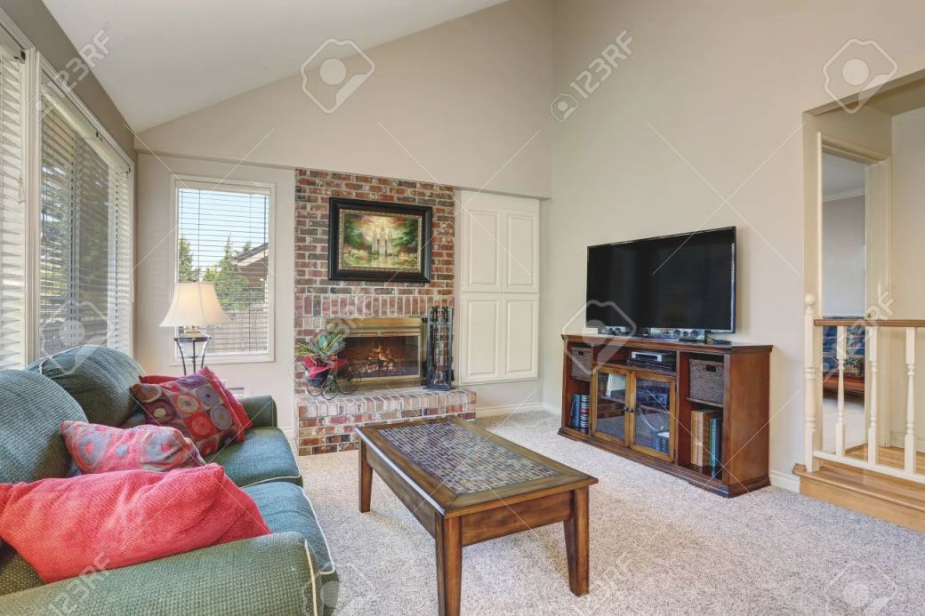 Traditional Living Room Interior With Green Sofa And Brick Fireplace regarding New Traditional Living Room Furniture
