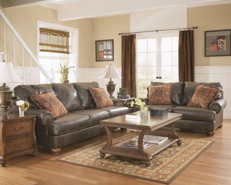 Truffle Color Rustic Living Room With Nailhead Deatils pertaining to Rustic Living Room Furniture