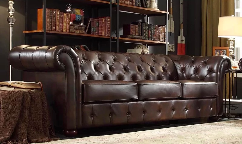 tufted-chesterfield-sofa-with-realistic-faux-leather-upholstery-and-thick-cushions
