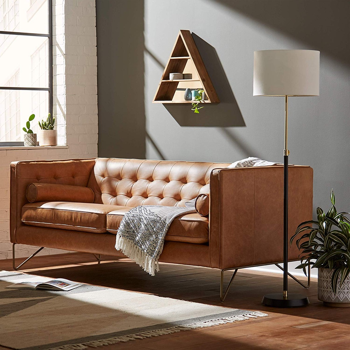 tufted-leather-sofa-with-tilted-seat-and-backrest