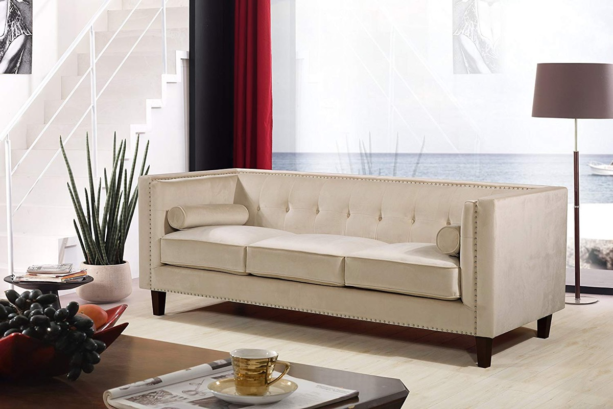 tufted-velvet-sofa-in-cream-with-included-bolster-pillows