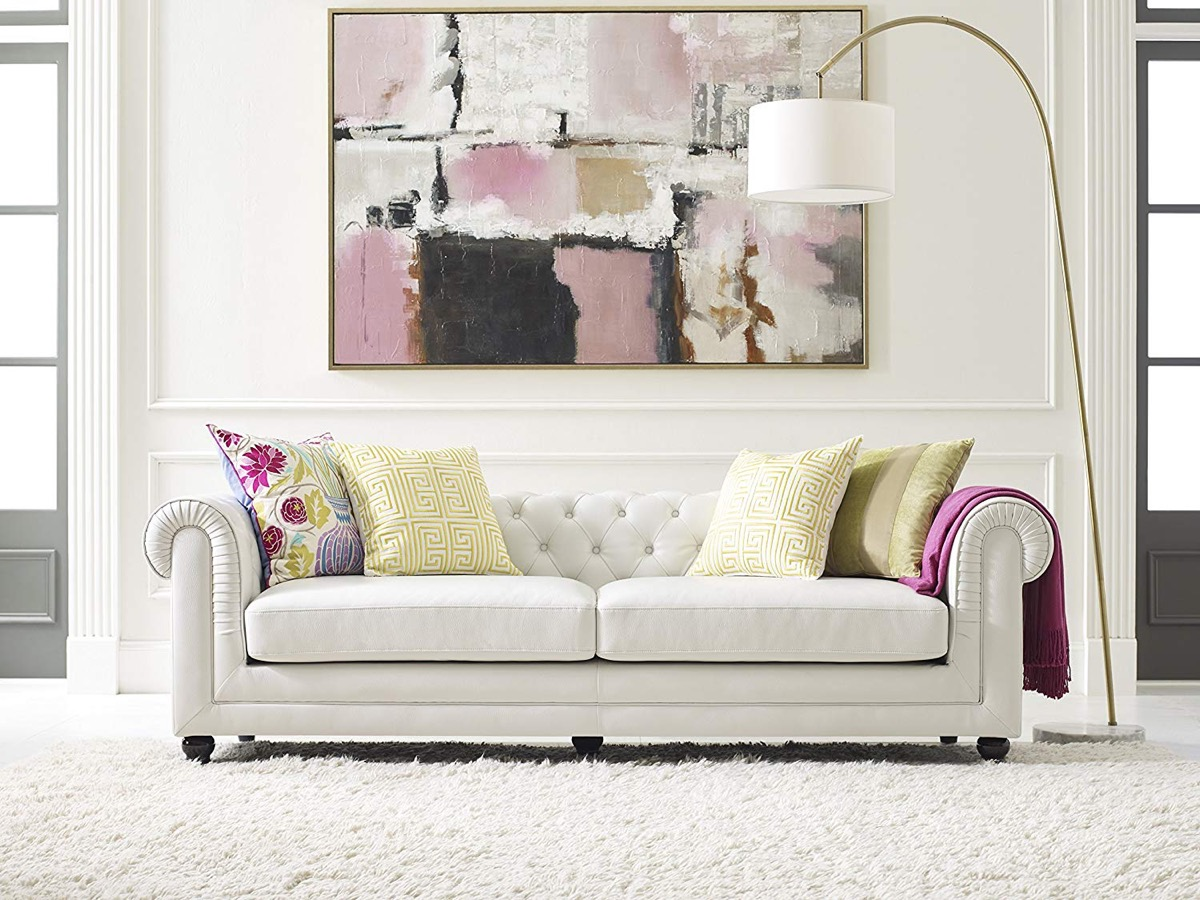 white-leather-tufted-sofa-with-low-back-and-rolled-arms-modern-chesterfield-style