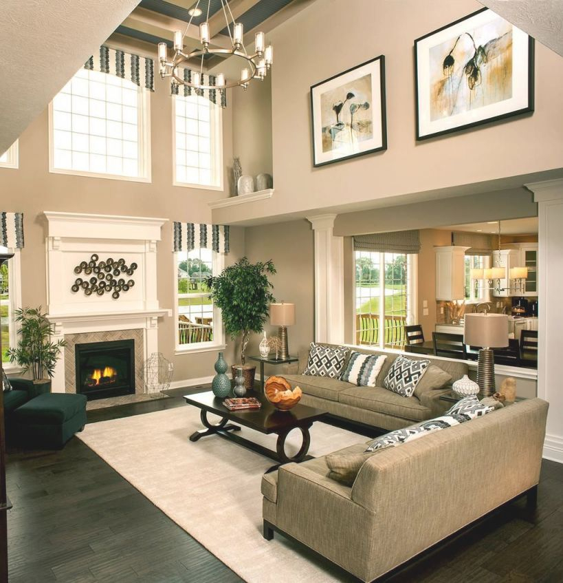 Breaking Up A Two Story Wall | Family Room Decorating regarding 2 Story Living Room Decorating Ideas