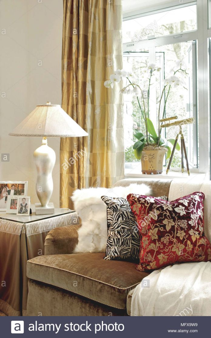 Cushions On Brown Sofa In Front Of Window With Gold Curtains inside Best of Curtains For Living Room With Brown Furniture