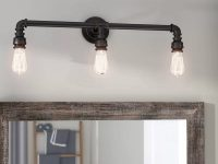 industrial-pipe-shaped-bathroom-vanity-lights-edison-bulbs