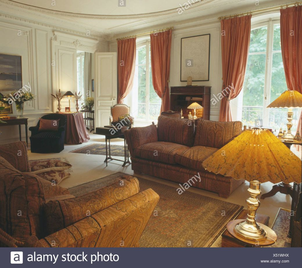 Lighted Lamps And Comfortable Brown Sofas In Country Drawing inside Curtains For Living Room With Brown Furniture