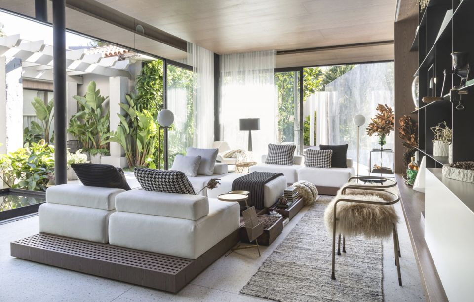 Small Open Plan Home With Jungle-Like Botanical Decor with Elegant Monochrome Living Room Decorating Ideas