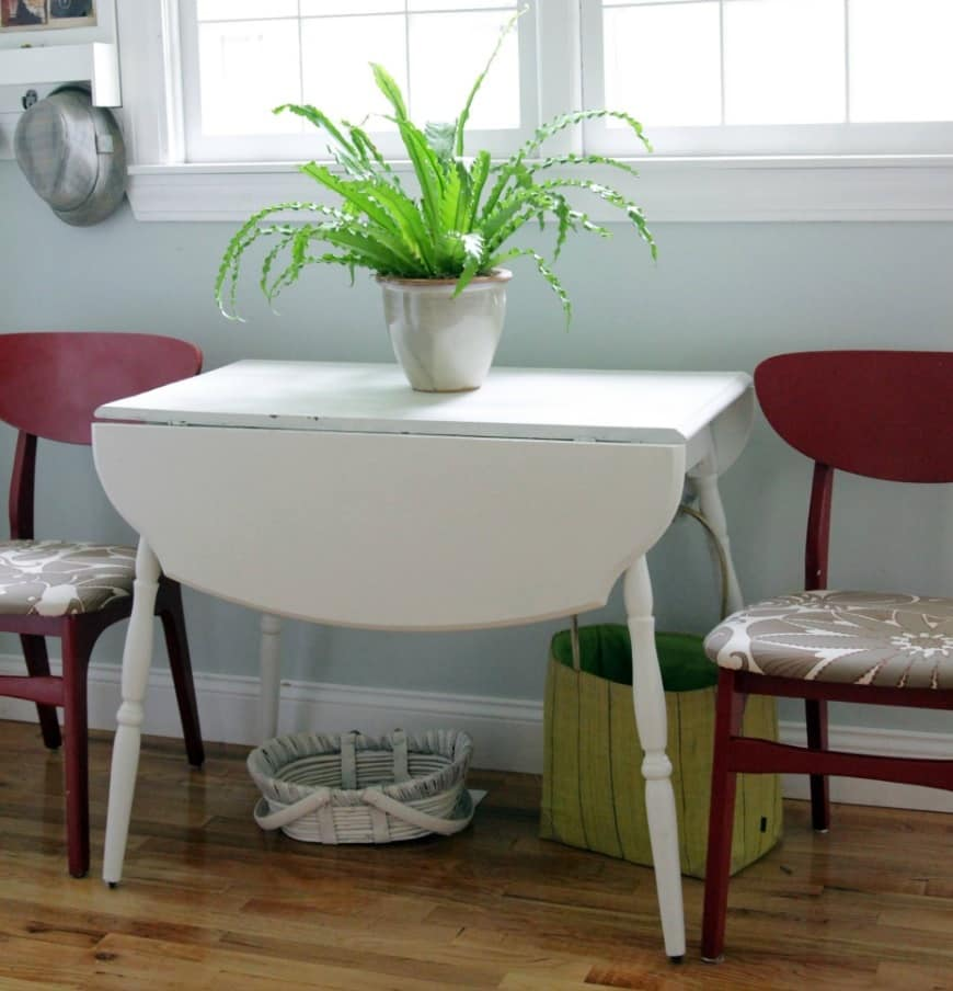 Mid Century Drop Leaf Table. Small improvised dining zone at the window with small white table and the plant on it