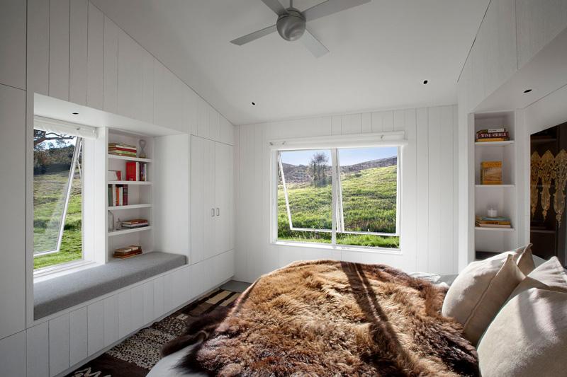 Custom-built window seat and bookshelf