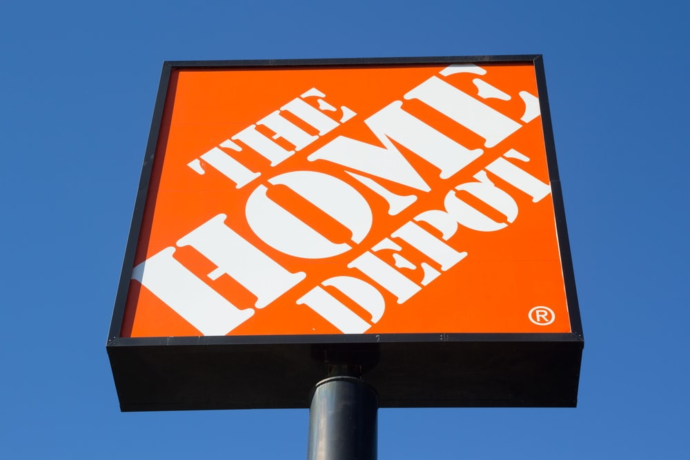 The Home Depot signage against a clear blue sky.