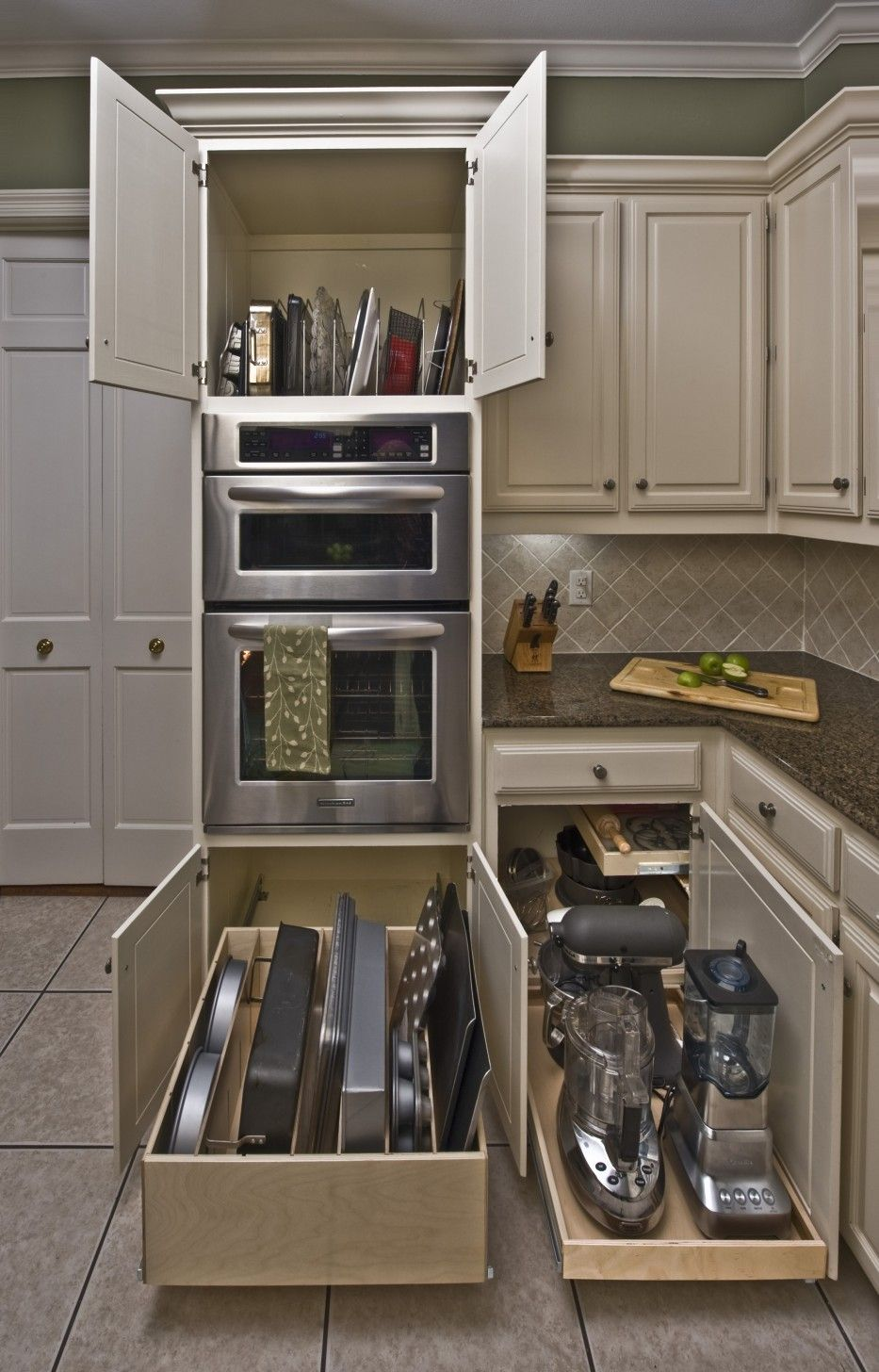 Organizing Kitchen Storage Systems and Pantry for Ultimate Comfort. Classic designed kitchen with long retractable shelves