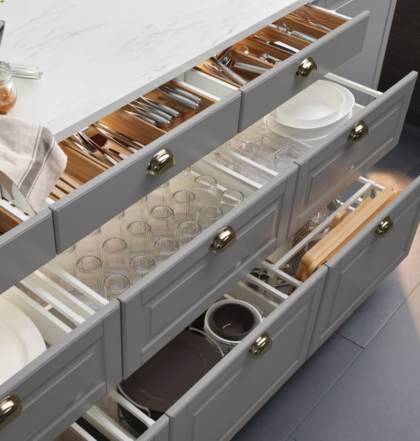 A lot of storage drawers for cutlery and glassware