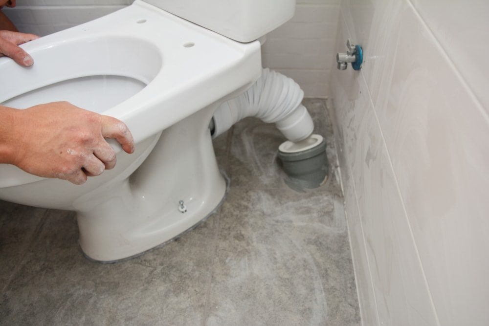 Installing a new toilet in the bathroom.