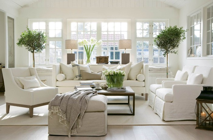 The Overview and Examples of Norwegian Interior Design. Classic English touch of the sunny interior with large sash windows and creamy white furniture