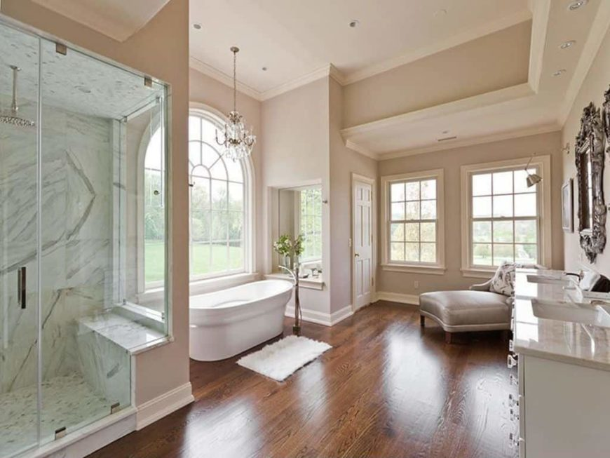 Master bathroom featuring a walk-in shower room and a freestanding tub, along with a sink counter with two sinks.
