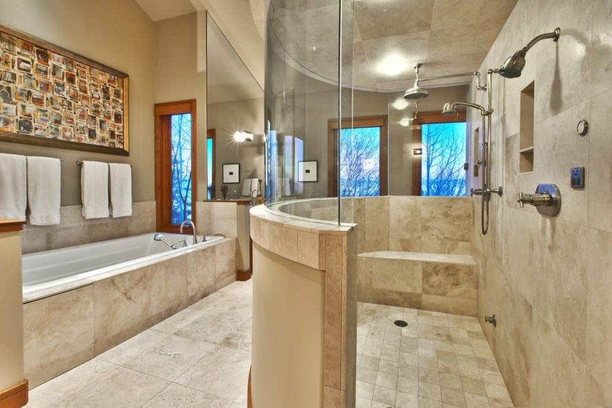 Master bathroom featuring a spacious walk-in shower room and a deep soaking tub on the side. The room features a tall ceiling and tiles flooring.