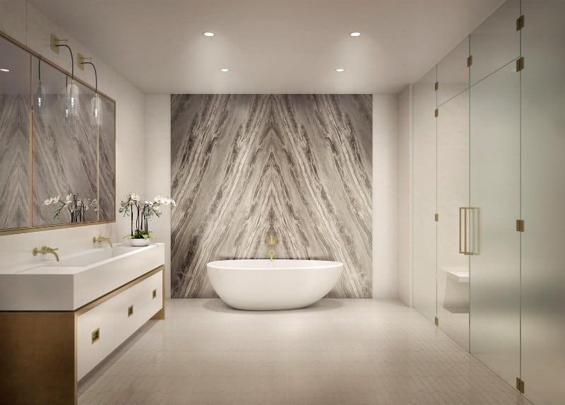 A master bathroom boasting a stylish wall beside the freestanding deep soaking tub. The room also offers a walk-in shower room.