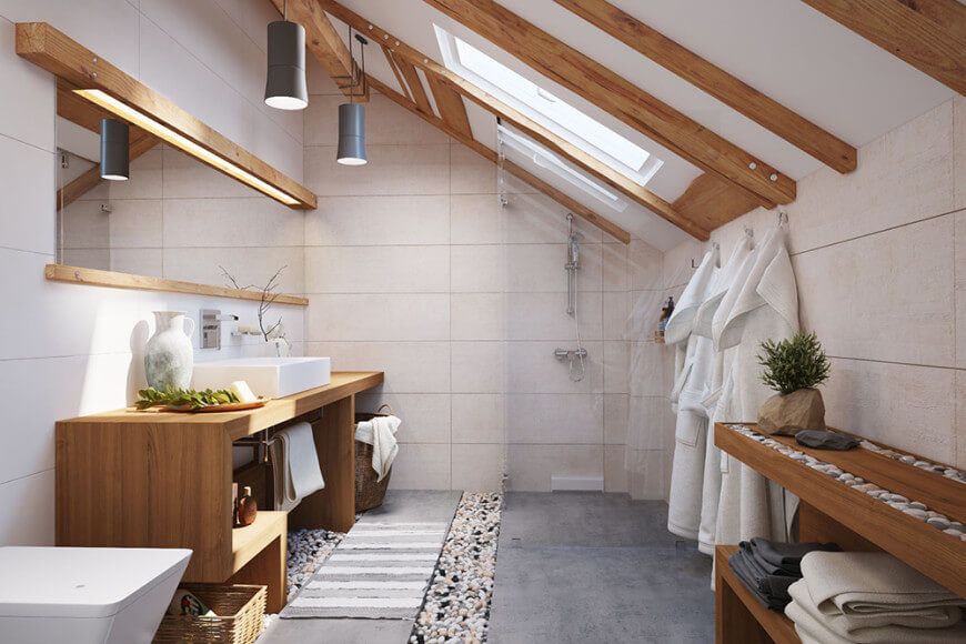 Master bathroom featuring a shed ceiling with beams and a skylight, along with a wooden sink counter and wooden shelving.