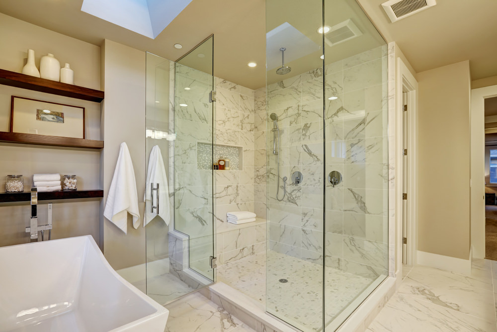 Master bathroom featuring a freestanding tub along with a walk-in shower room. The room features built-in shelves and a skylight.