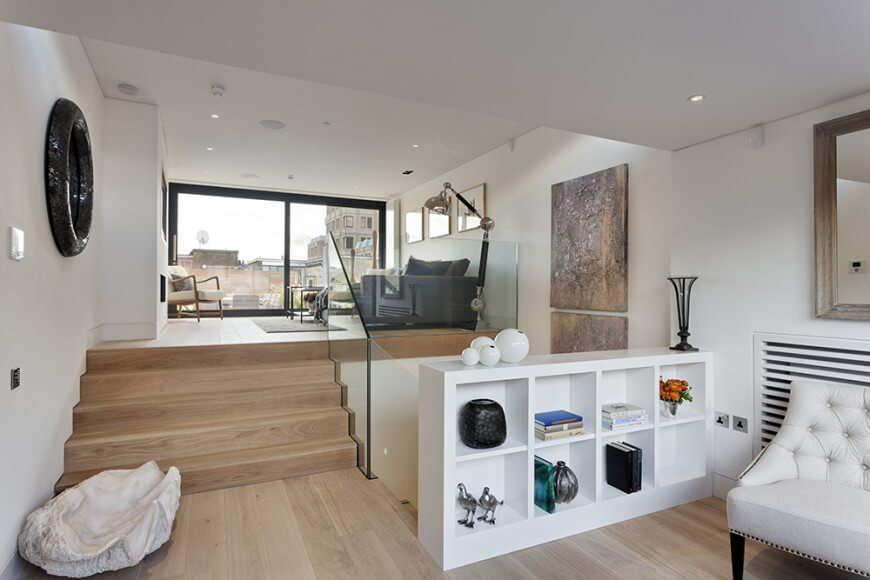 A look at the home's custom living space, featuring hardwood floors and white walls, along with a white ceiling.