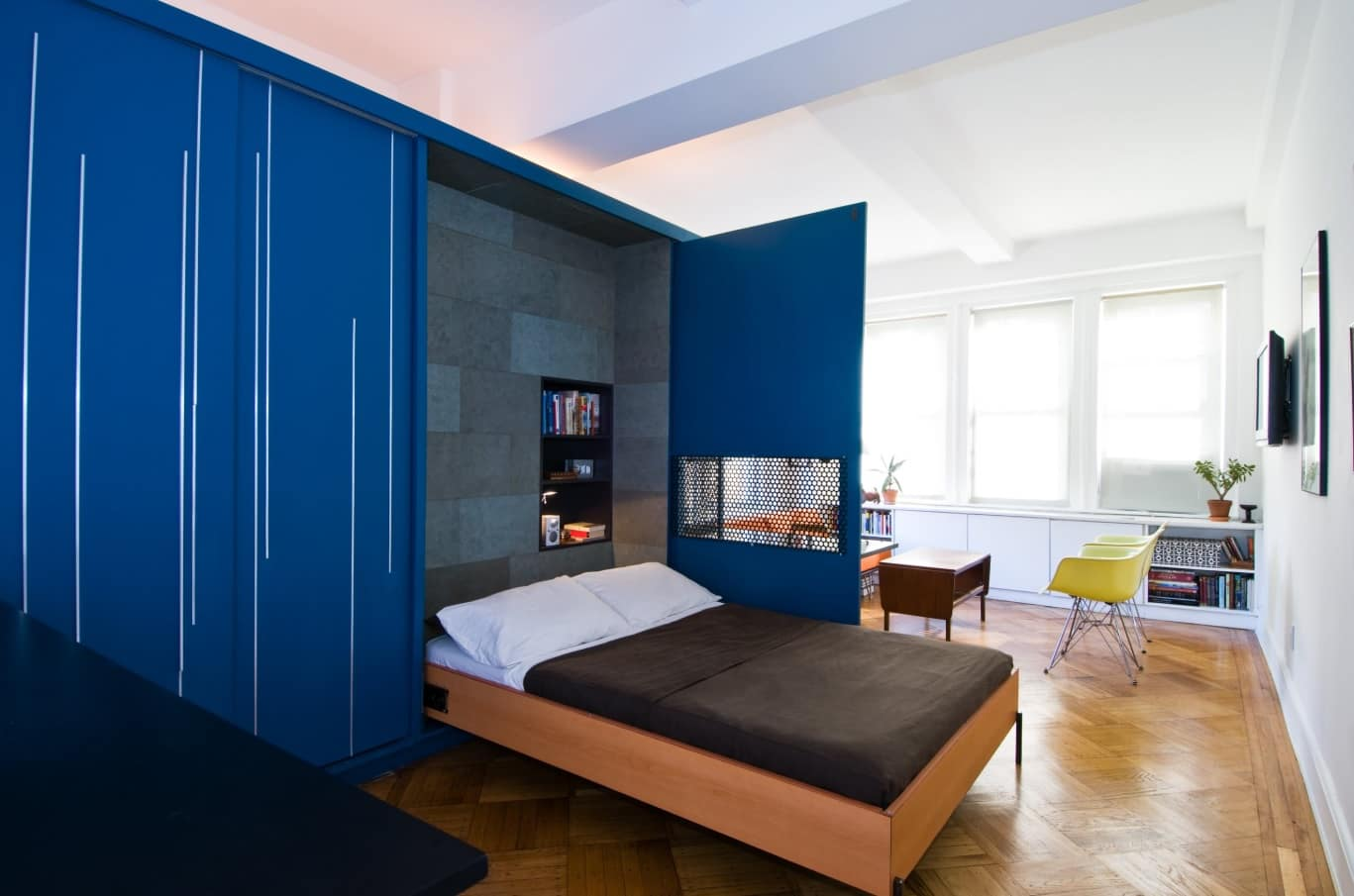 How Many Are Staying? 5 Must-Know Guest Sleeping Solutions. Murphy bed from out the blue cabinet of modern apartment